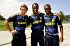Shevchenko, Drogba and Sturridge pose in the new away kit: Darren Walsh/Chelsea FC via Getty Images