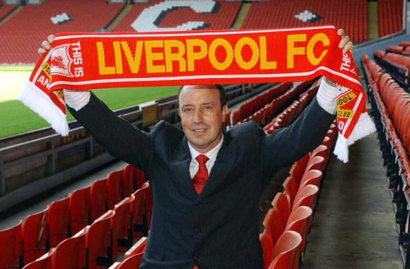 Spaniard Rafael Benitez hold up a Liverp