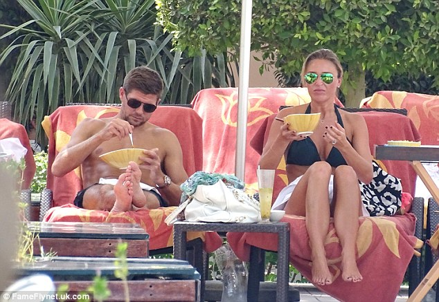 Steven Gerrard and Alex Curran eating on holiday