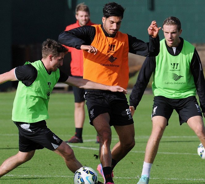 Joe Allen, Emre Can and Jordan Henderson in training