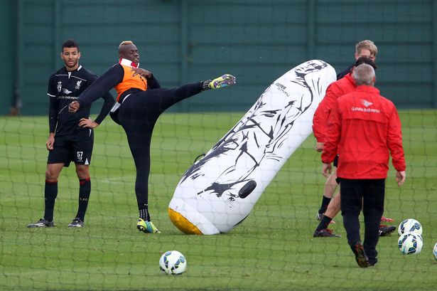 PAY-Mario-Balotelli-shows-off-his-karate-skills-with-a-high-kick-to-an-inflatable-training-dummy