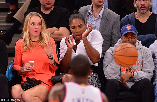 Caroline Wozniacki and Serena Williams at the New York Knicks as ball comes close