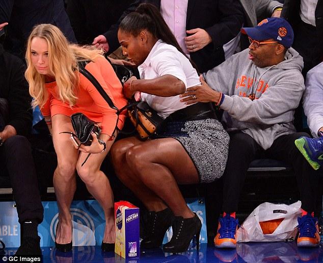 Caroline Wozniacki and Serena Williams flinch at the New York Knicks