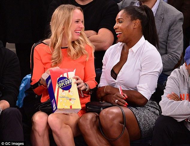 Caroline Wozniacki and Serena Williams having fun at the New York Knicks