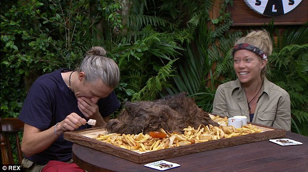 Jimmy Bullard eating camel's hump next to Kendra Wilkinson