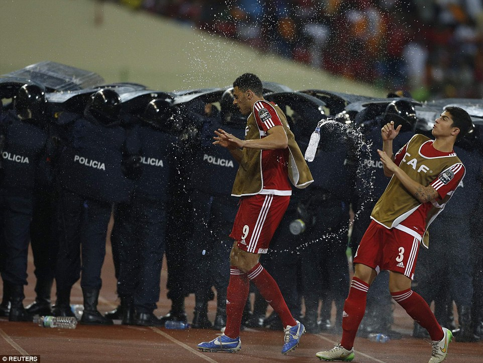 255FDE7A00000578-2941812-Equatorial_Guinea_fans_are_pelted_by_water_bottles_as_they_try_a-a-63_1423173831503