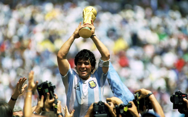Diego Maradona lifting the World Cup with Argentina