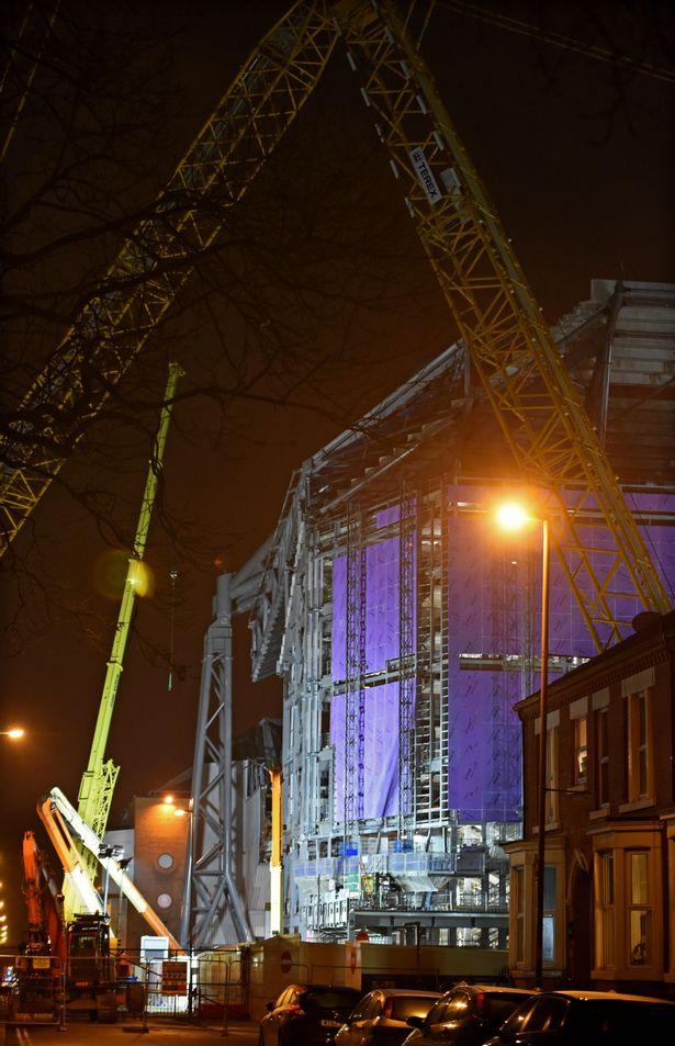 Liverpools-Main-Stand-construction-illuminated-at-night-1