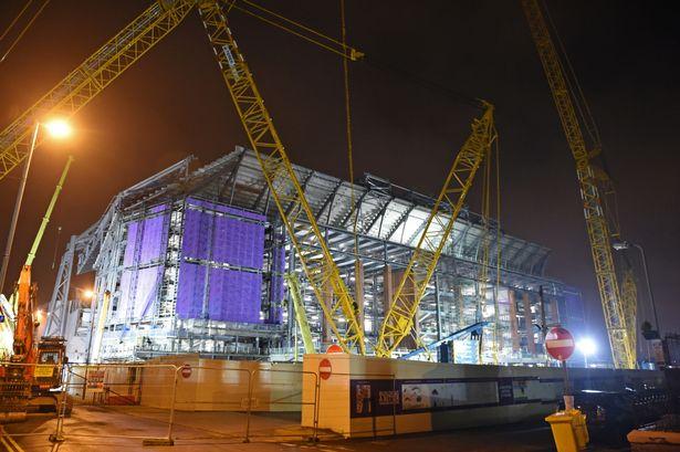 Liverpools-Main-Stand-construction-illuminated-at-night-2