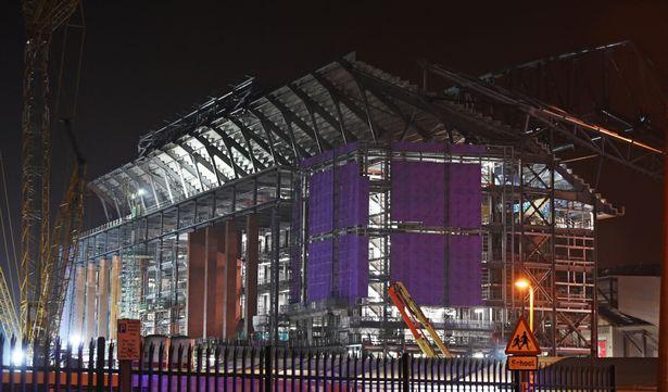 Liverpools-Main-Stand-construction-illuminated-at-night