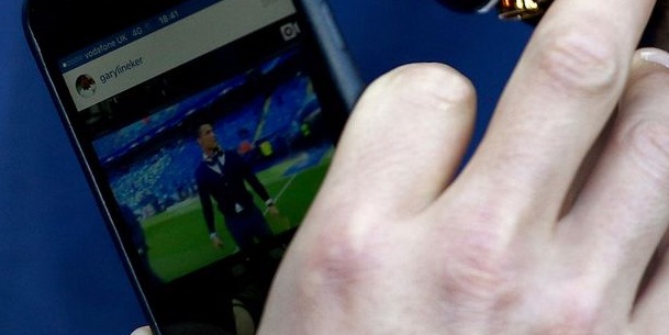 Cristiano Ronaldo ignores Man City v Real Madrid to look at Cristiano Ronaldo on Instagram (close up)
