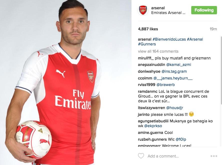 Lucas Perez sad in Arsenal signing photo