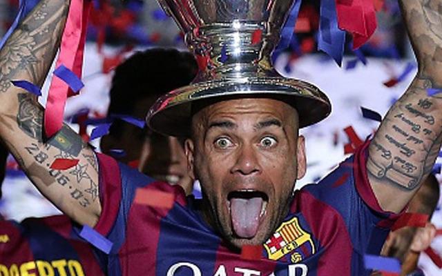 Dani Alves lifting Champions League trophy