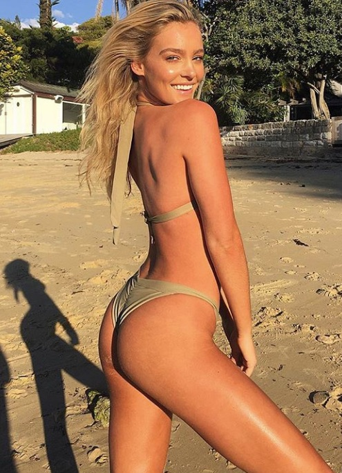 Georgia Gibbs suns herself on the sand