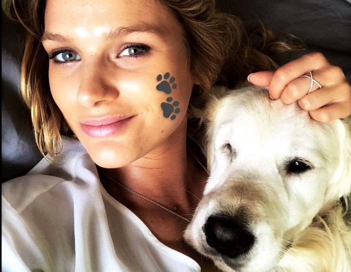 Mayte Rodriguez shared a cute moment with one of Alexis Sanchez's golden retrievers