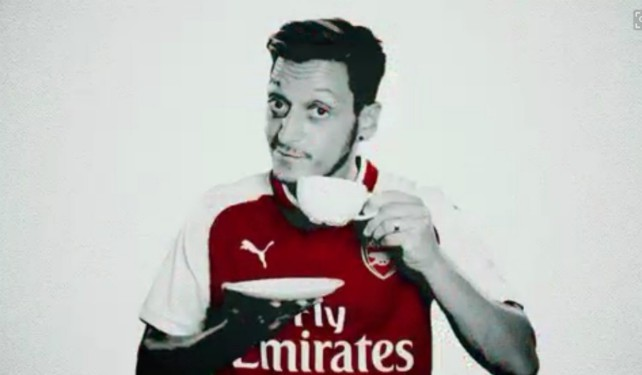 Mesut Ozil drinking a cup of tea