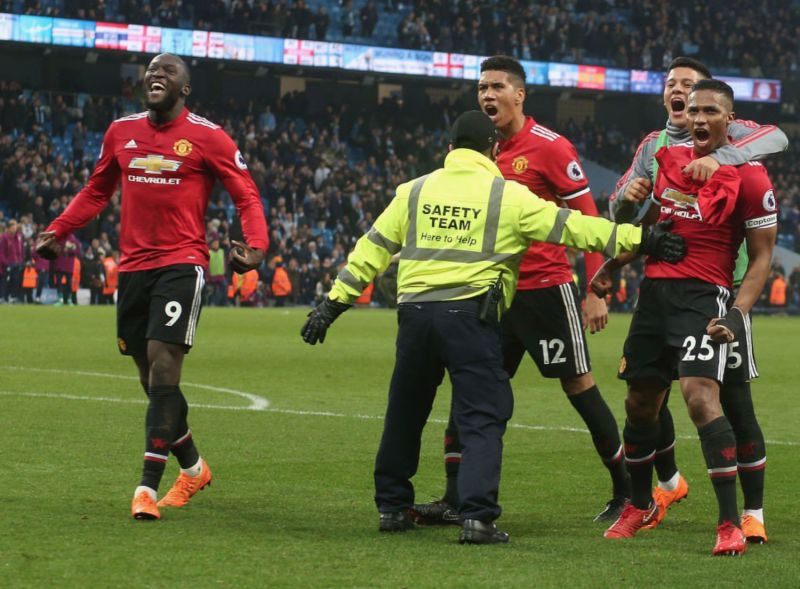 Manchester United players celebrate after full-time.