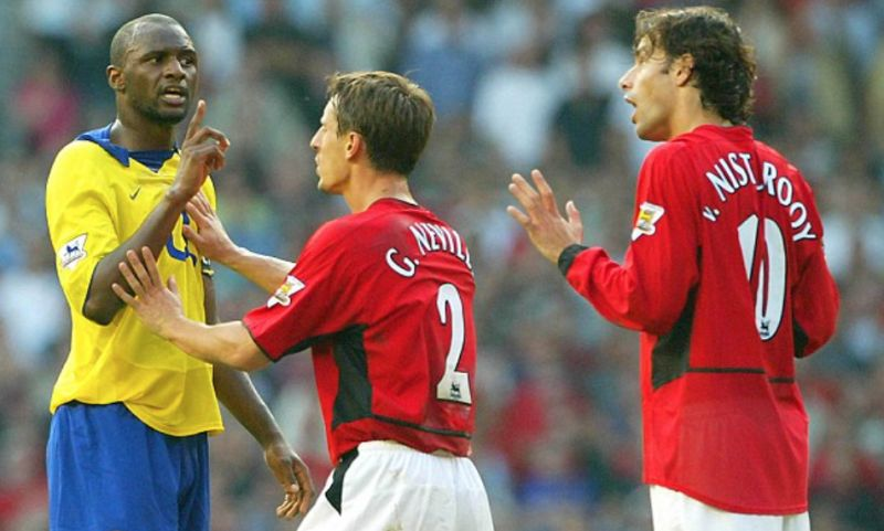 Gary Neville attempts to calm down Patrick Vieira during a heated Man United vs Arsenal clash