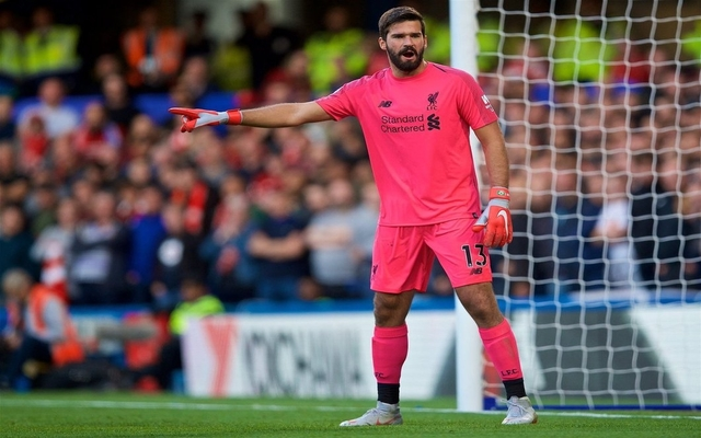 Alisson in action for Liverpool - Pink kit