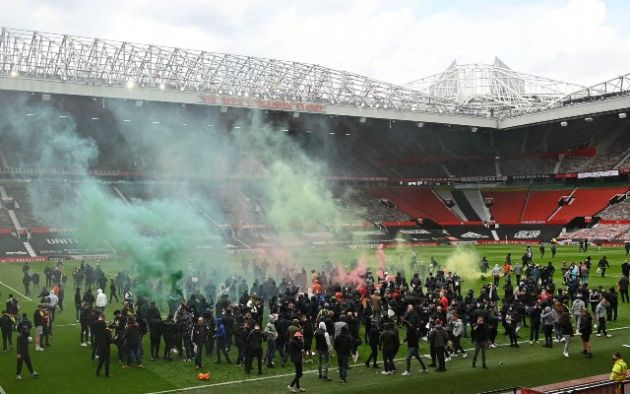 Fans on Old Trafford pitch