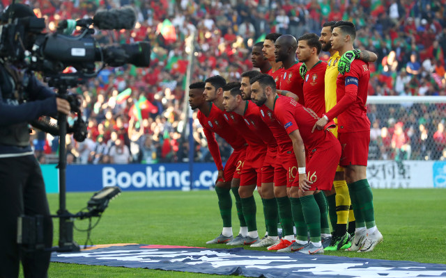 Cristiano Ronaldo poses with his Portugal teammates in 2019 while standing on his tip toes