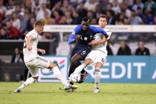 Leon Goretzka and Toni Kroos battle Paul Pogba -